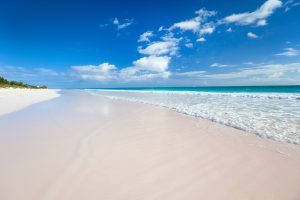 White sandy beach and sea on bahamas yacht charter