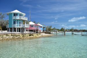 Colourful yacht club buildings on pillars during bahamas yacht charter