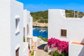 Cala Portinatx white houses during Balearic yacht charter