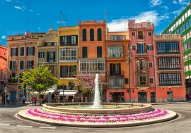 Palma de Mallorca houses and fountain during Mediterranean yacht charter