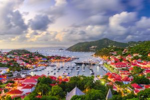 Town at sunset with yachts on Caribbean yacht charter