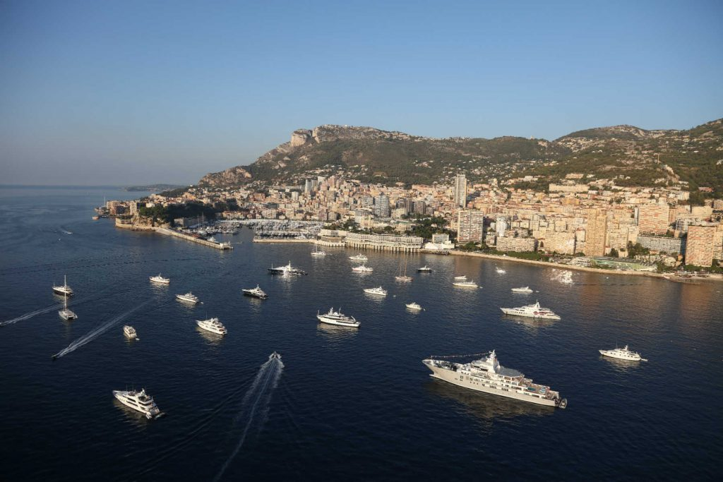 view of monaco during the monaco yacht show with yachts in the sea